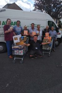 John Tinsley, Paul Harrison, Penny Cliff, Mark Dockerty (Mexborough Foodbank volunteers), Genny New, Joan Nairn, Ronnie Nairn (Mexborough Lions), front - Sean Gibbons, MFB Manager