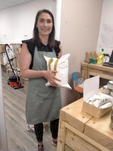 Emma from Re-Fill and Food AWARE CIC supporting Banana Box Toy Project
